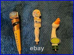 3 beer tap handles Modelo, Goose island, Samuel Adams